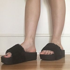 Chunky, furry, black platform slippers